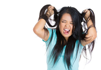 Stressed young woman overwhelmed isolated white background