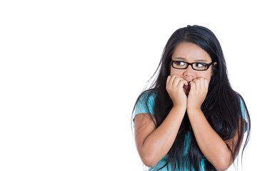 Scared anxious young woman biting fingernails white background