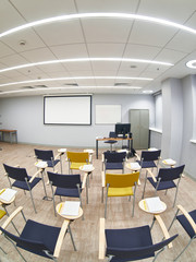 Empty classroom with сhairs and notepads