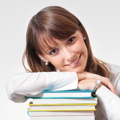 Cheerful smiling young woman with textbooks