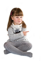 Smiling little girl indicating the something, white background