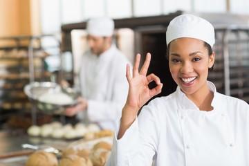 Pretty baker smiling at camera