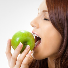 Cheerful woman eating apple