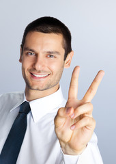 Businessman showing two fingers