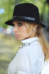 Profile of a girl in black hat