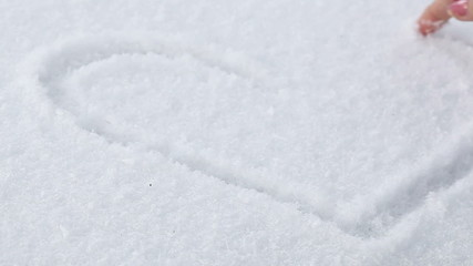 Drawing heart in snow
