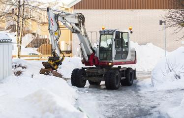 Excavator removing snow