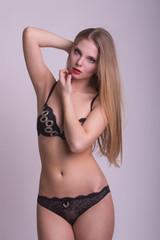 Hot blonde woman in lingerie posing in the studio