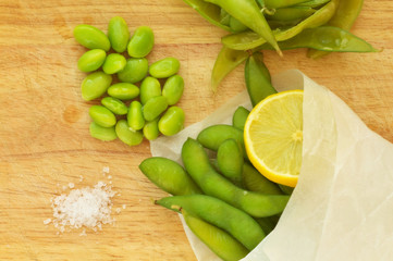 Edamame, soy beans on a wooden background