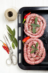 homemade raw sausage with herbs aromatic & fresh red pepper. rea