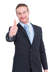 Positive businessman smiling with thumb up