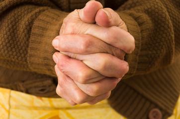 closeup shot of grandmother's hands praying