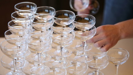 The waiter distributes to guests champagne