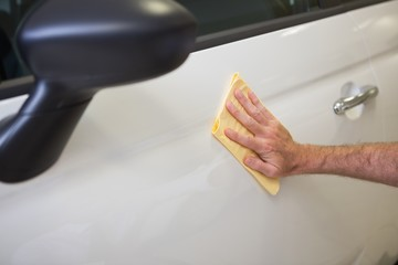 Close up of man cleaning his car