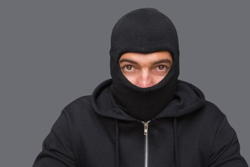 Man in balaclava looking at camera