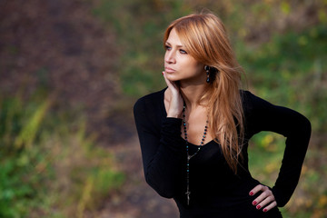 Beautiful mysterious girl in the autumn forest