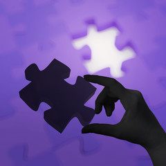 female hand placing last piece of Puzzle as concept