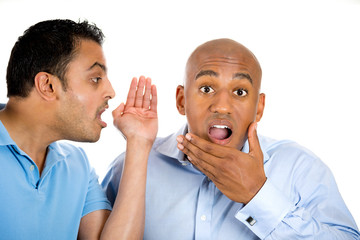 guy whispering into man's ear telling him something secret