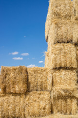 Bales of hay, Pile over blue sky