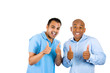 Two excited young men showing thumbs up sign
