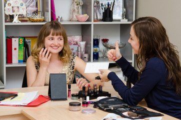 Makeup artist satisfied with results of client to consult