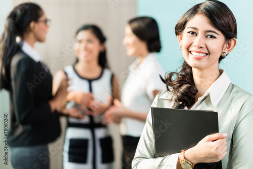 canvas print picture Indonesian Business woman in front of team