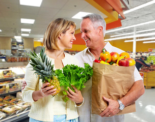 Elderly couple with vegetables.