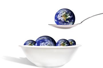 Erde auf Löffel