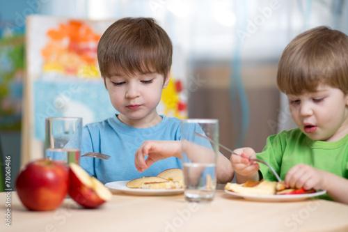 kids eating healthy food at home - 78068486