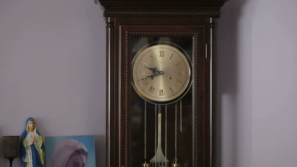 Old antique clock with statuette of the Virgin Mary
