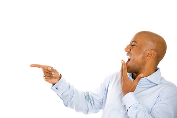 Side profile man laughing, pointing with finger at someone