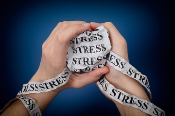"Word ""Stress"" in woman's hands"