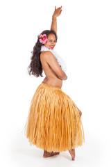 Young hula dancer looking over her shoulder