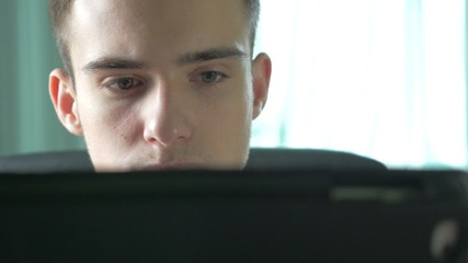 4k UHD - Young man browsing on a tablet pc