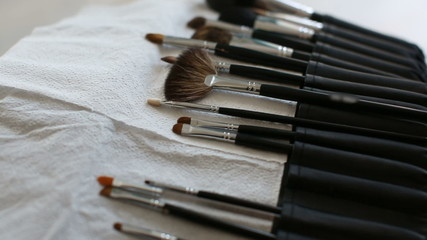 Brush make-up on the table. Makeup artist takes the brush
