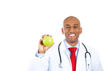 Happy smiling young doctor with green apple