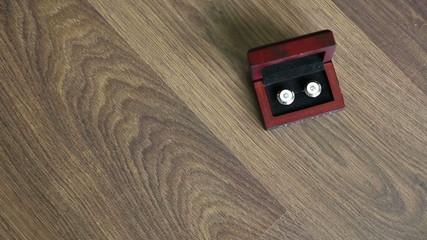 Cufflinks at wooden background