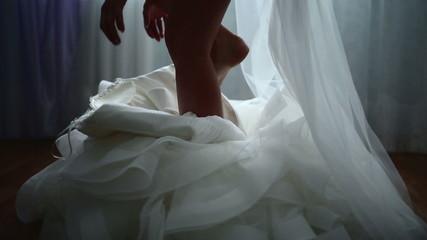 Buttoning the wedding dress
