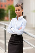 Portrait of attractive businesswoman smiling towards the camera