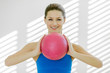 Portrait of smiling woman with a gym ball