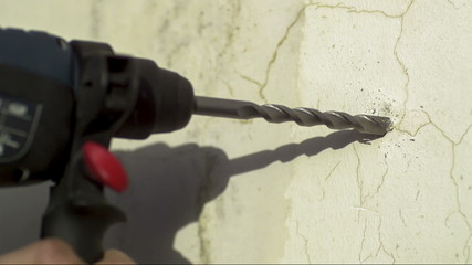 Drill on concrete Wall