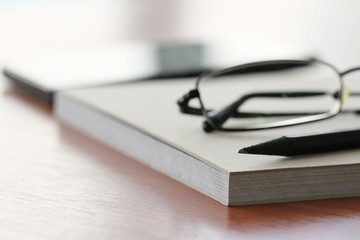 close up of Blank notepad with pencil on office wooden table