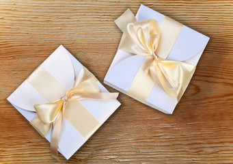 Two boxes with golden bow