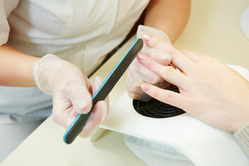 Manicure specialist in beauty salon
