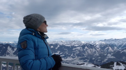 Woman in the mountains looking at beautiful view, Alps