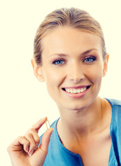 Portrait of young smiling woman with Omega 3 fish oil capsules