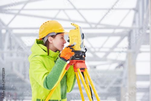 surveyor works with theodolite - 78072289