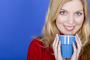 Model Released. Attractive Young Woman Holding Cup Coffee