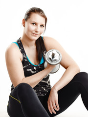 Girl and dumbbell