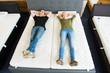 zufriedenes pärchen  auf matratzen - 78073084